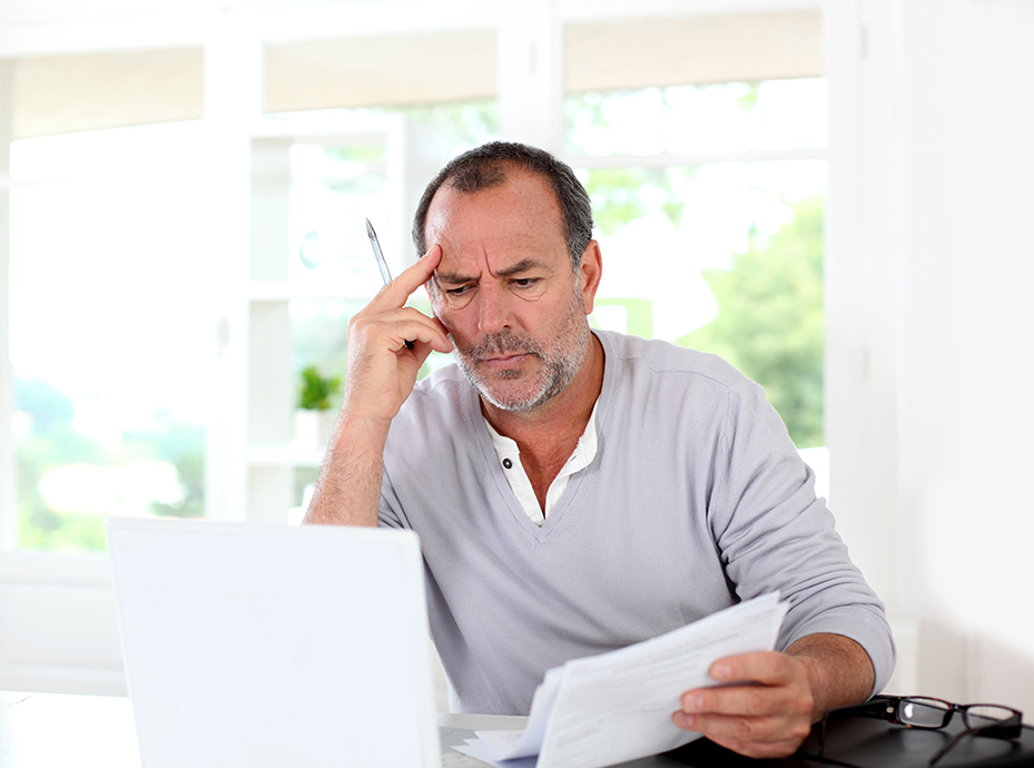 Senior man being puzzled with tax documents